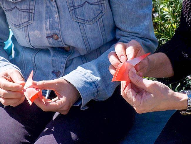 Students folding paper cranes, April, 2010
