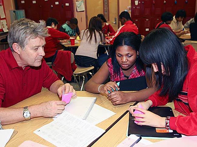 Robert Croonquist and students make origami cranes, December, 2010