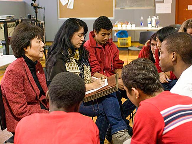 Reiko Yamada and interpreter Marie Cochrane speak to a small group, December, 2010