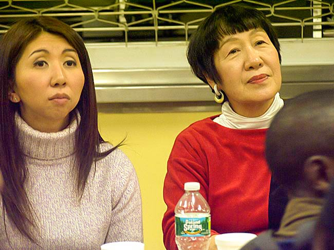 Interpreter Fumi Furman and Toshiko Tanaka listen to students, December, 2010