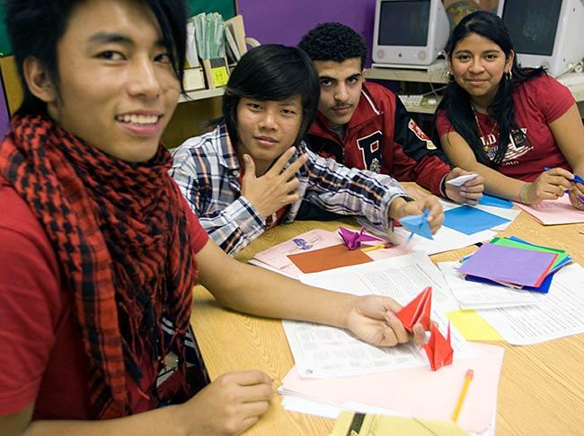 Students make origami cranes