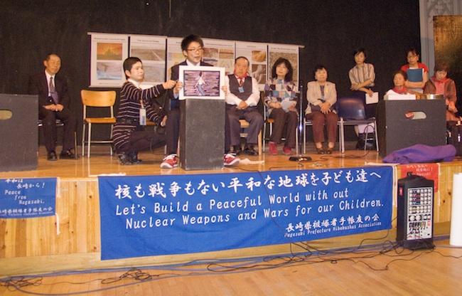 Nagasaki student with kamishibai, a Japanese storyboard, May, 2010