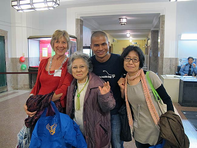 Dr. Cynthia Miller, Shigeko Sasamori and Miyako Taguchi with a student from W.C. Bryant High School, May, 2012