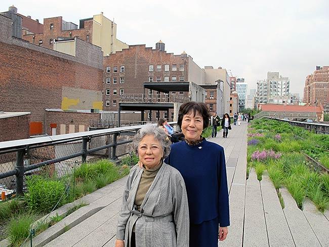 Shigeko Sasamori and Reiko Yamada in front of the Williams and Baker Warehouse