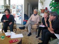 Setsuko Thurlow, Yasuaki Yamashita, Sandy Parker and Debbie Brindis take notes as they learn of the upcoming week's work, December, 2011