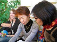 Miyako Taguchi interprets for Hiroko Sakaguchi and Debbie Brindis listens as Emilie McGlone speaks, December 2011
