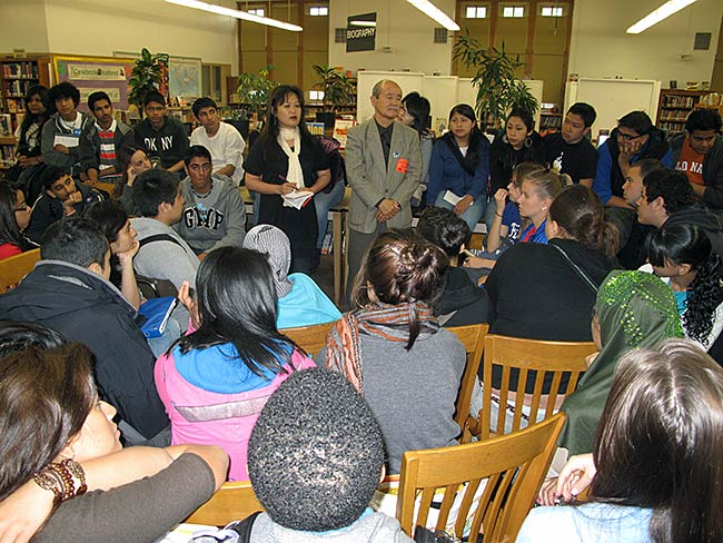 Hirosi Iso listens to questions from students at W.C. Bryant High School, May, 2010