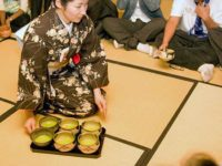 The tea is served by women dressed in traditional Japanese kimonos