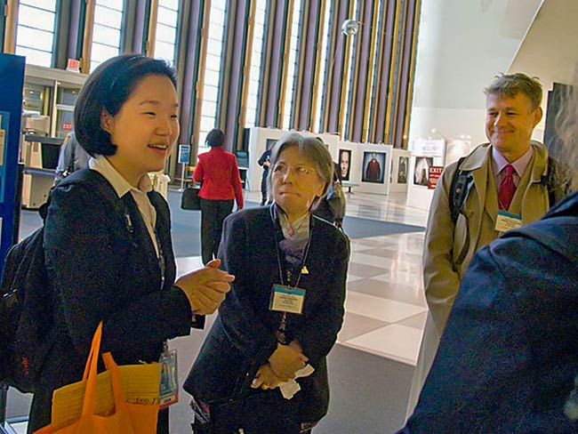 Soo-Hyun Kim from the United Nations Office for Disarmament Affairs greets Shigeko Sasamori and Robert Croonquist, May, 2011