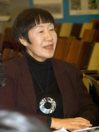 Toshiko Tanaka wears enamel jewelry of her own creation, December, 2010