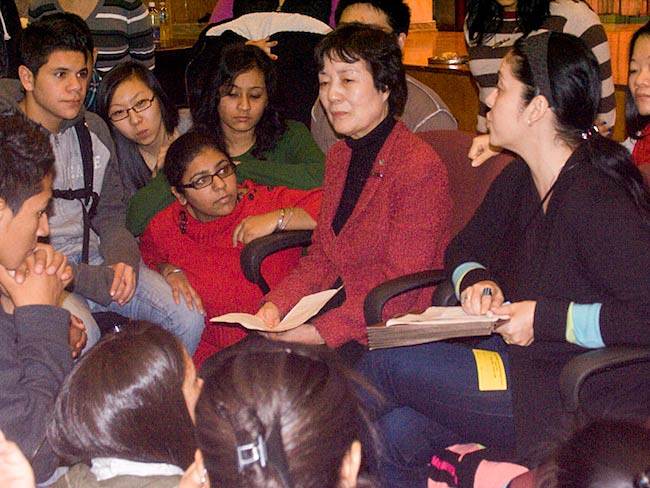 Students listen to Reiko Yamada as Marie Cochrane interprets, December, 2010