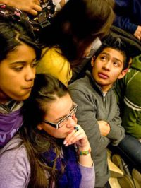 Students huddle close to one another as they hear of the horrific experiences of the hibakusha, December, 2010