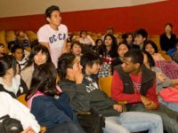 A student rises to ask a question, December, 2010