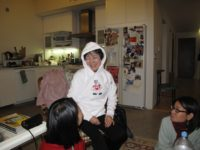Reiko Yamada modeling a hoodie, gift of St. Francis Prep, Queens, December, 2010