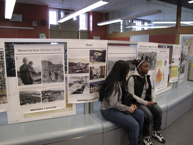 Librarian Karen Levy displays posters donated by the Hiroshima Peace Culture Foundation at the Christopher Columbus Educational Complex, December, 2010