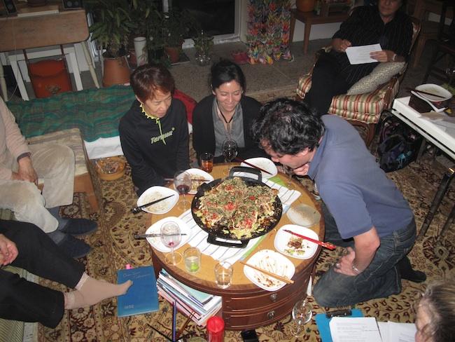 Taku Nishimae prepares a okonomiyaki, December, 2011