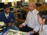 Nagasaki hibakusha has a private moment with a student from the High School for Social Justice, Bushwick, May, 2010
