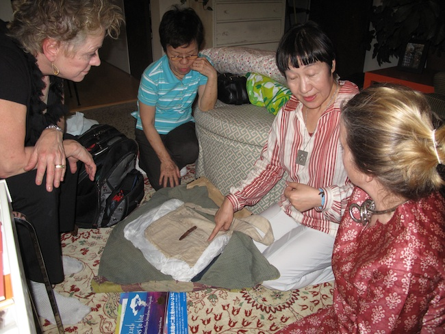 Toshiko Tanaka displays the satchel that she had with her the day of the bombing of Hiroshima, May, 2010