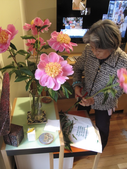 "Shigeko Sasamori arranges peonies, ""Each peony must show its face."" May 2010"