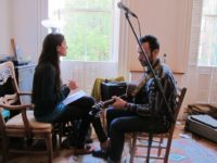 Jean Rohe and Ilusha Tsinadze set up before performing at the Hibakusha Stories benefit, May, 2013