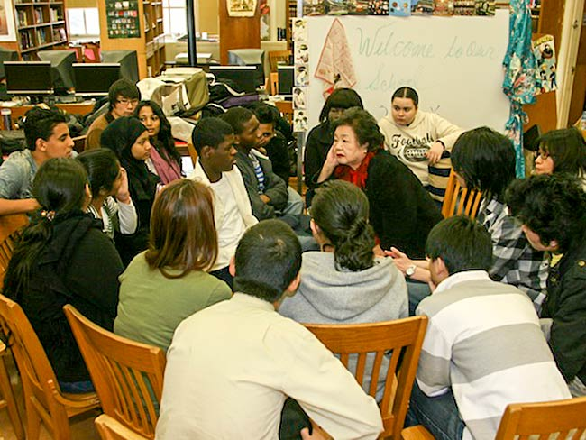 Setsuko Thurlow listens carefully to what students have to say, December, 2010