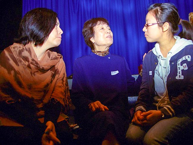 Reiko Yamada listens to a student as Marie Cochrane interprets, May, 2012