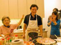 Shigeko Sasamori and Ayumi Temlock celebrate Chef Taku's creation, May, 2011