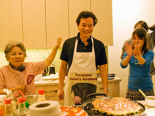 Shigeko Sasamori and Ayumi Temlock celebrate Chef Taku's creation, May, 2011