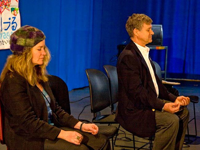 Kathleen Sullivan and Robert Croonquist lead a meditation at the beginning of the workshop, May, 2010