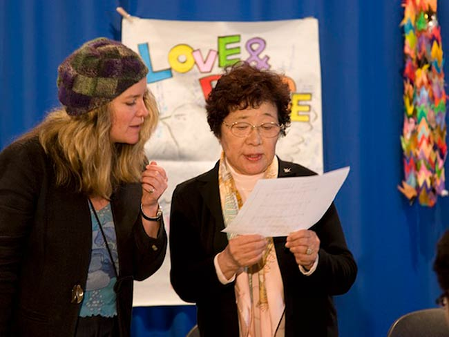 Michiko Tsukamoto and Kathleen Sullivan lead the group in a popular American song whose words were adapted to fit the occasion, May, 2010