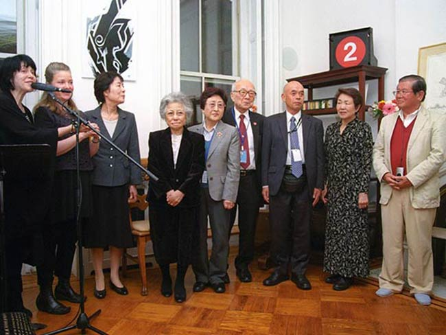 Seven hibakusha from Hiroshima and Nagasaki with Kathleen Sullivan & Marie Cochrane