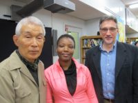 Yasuaki Yamashita and Clifton Daniel (far right) with student at East Side Preparatory