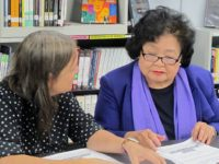 Deb Brindis and Setsuko Thurlow prepare at Aspirations High School