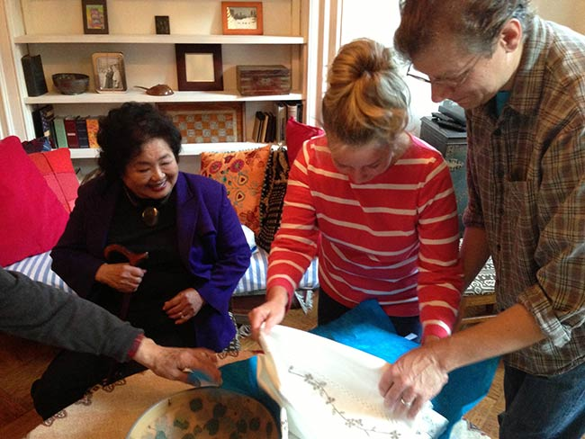 Kathleen Sullivan and Blaise Dupuy open wedding gift from Setsuko Thurlow