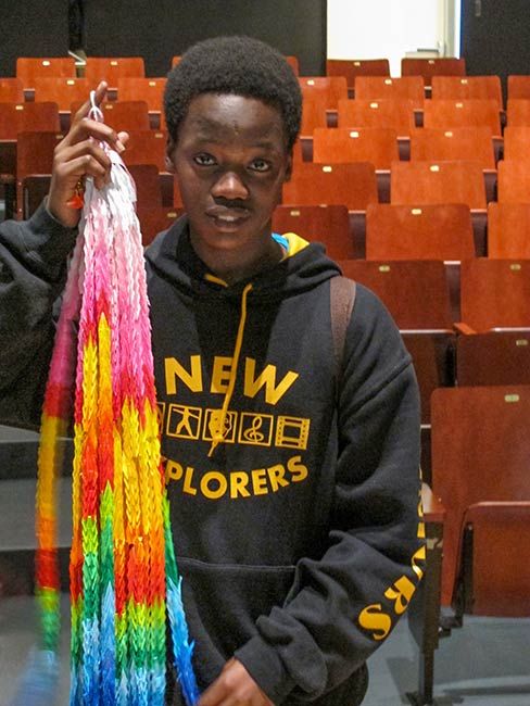Student with gift of origami cranes, Mott Haven