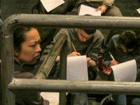 Sophia Skiles looks on as students write monologues