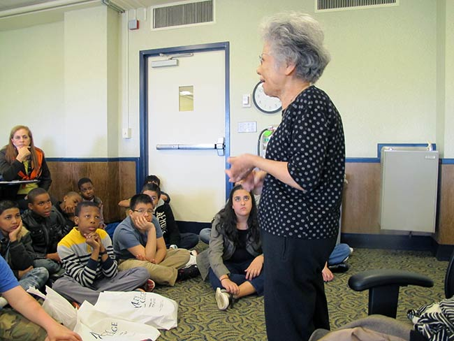 Shigeko Sasamori speaks with students