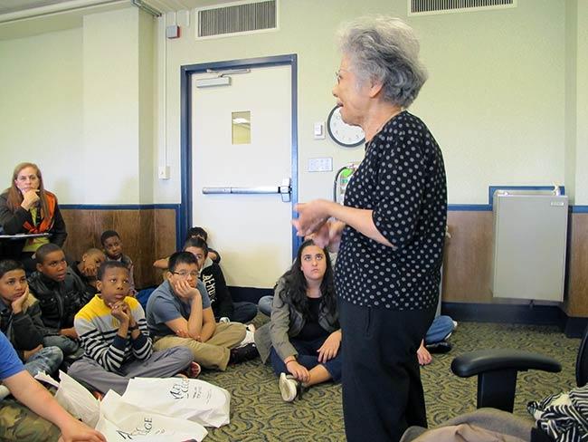 Shigeko Sasamori speaks with students