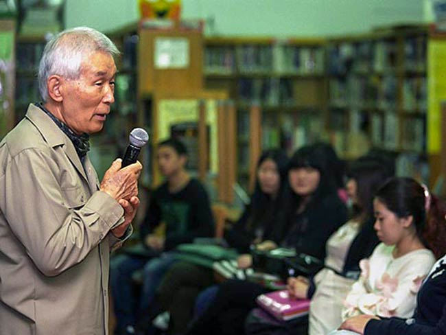 Yasuaki Yamashita speaking at East Side Preparatory High School