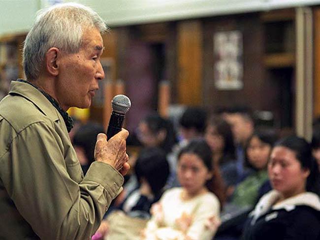 Yasuaki Yamashita speaking at East Side Preparatory High School
