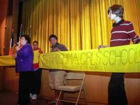 Setsuko Thurlow showing the banner from Jogakuin High School
