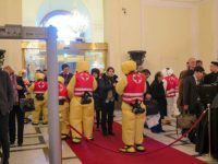 As a theatrical gesture, the entry had actors in Hazmat suits