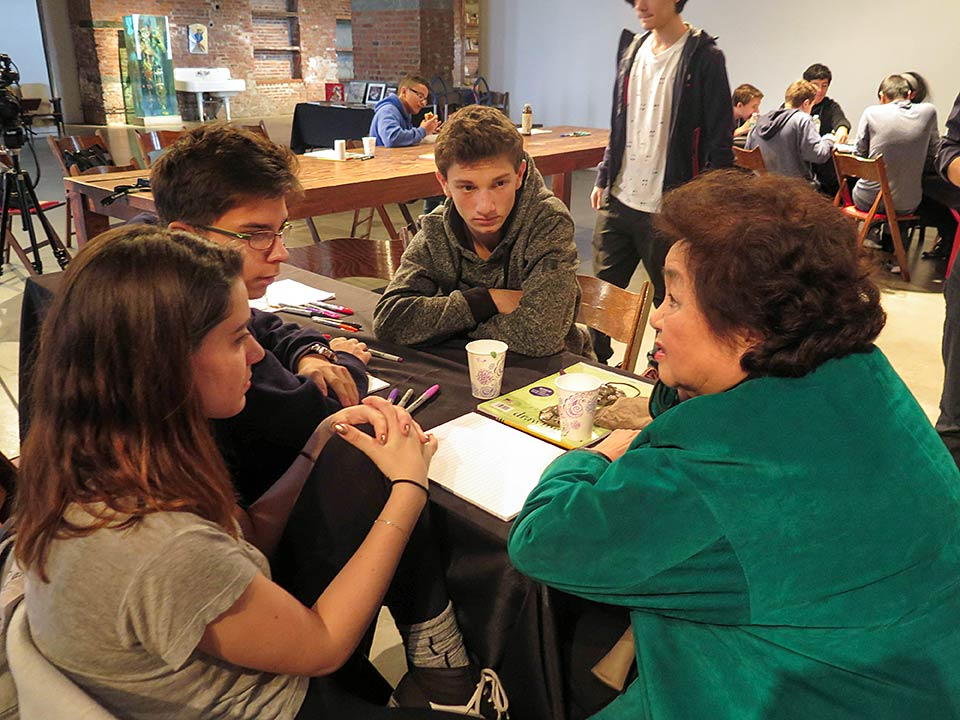 Setsuko Thurlow with students from the NYC i-School